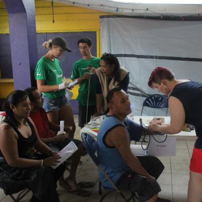Projects Abroad volunteers checking blood as part of her Spring Break Public Health Project in Belize